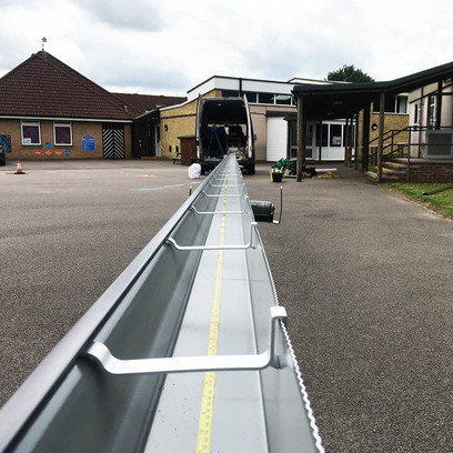 Commercial box guttering being extruded for a commercial property.