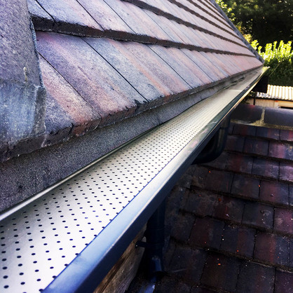 Close up of Mustang seamless gutter with leaf-guard installed.