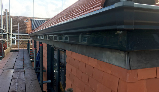 Commercial property with black seamless aluminium guttering. Durable and low-maintenance.