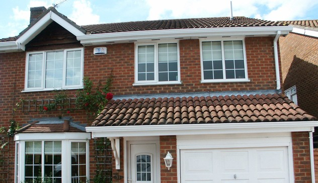 Seamless aluminium guttering installation on a domestic property.
